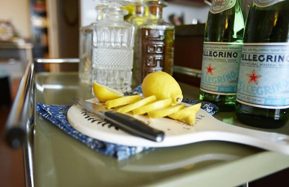 These cut lemons on this chic cutting board look great on the bar cart.
