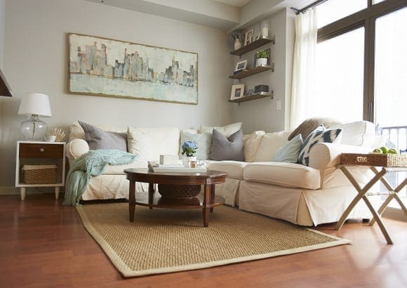 The neutral couch in this living room looks awesome with the colored throw pillows.