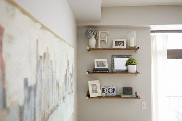 The shelves in this family room are great for plants and picture frames.