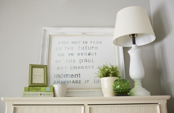 The green decor accents pair well with the neutral, white tones.
