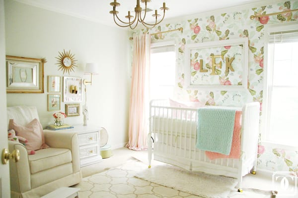 This classic nursery is decorated light with pastels and floral inspiration.