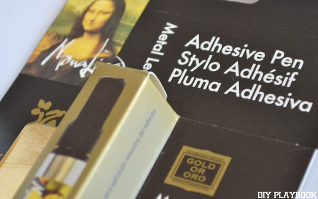 Most gold leaf kits come with an adhesive pen and a dozen sheets of gold leaf.