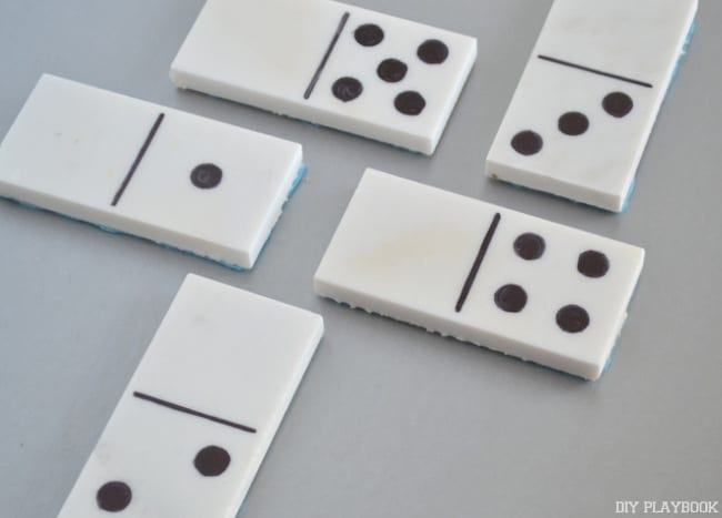 Once domino playing tiles are assembled, lay them out.