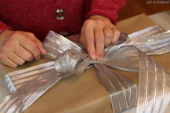 Place your bow on the base of the package, right in the middle.