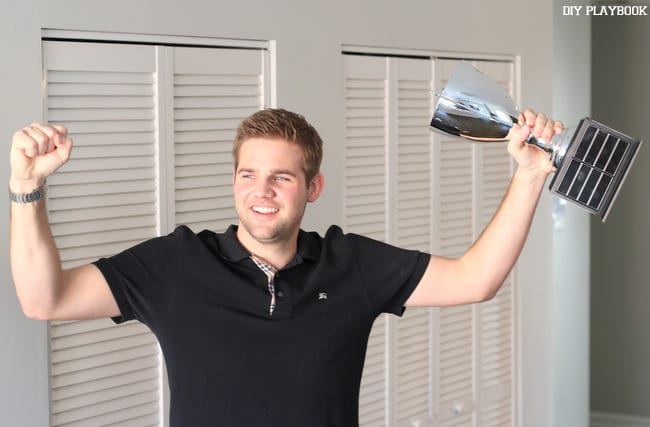 finn and his fantasy football trophy is a prized possession