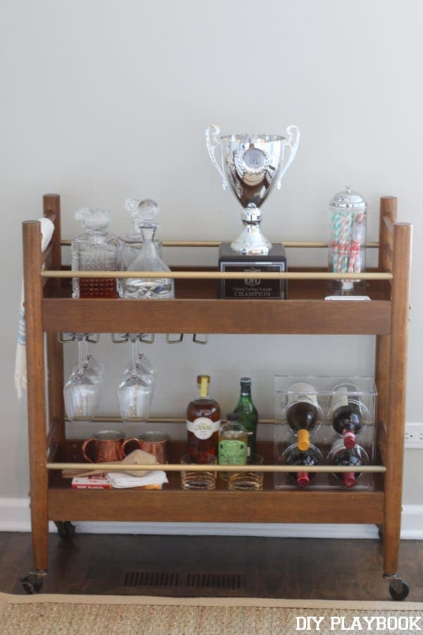 the football trophy spent some time on the cocktail cart
