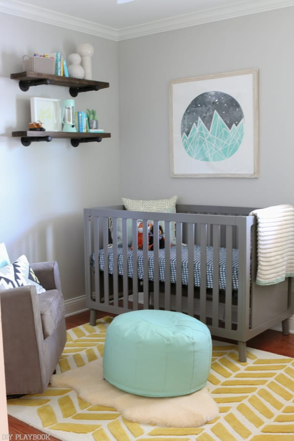 The pops of turquoise in this baby nursery are so cute.