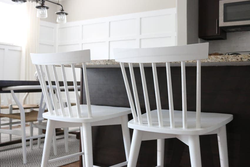 New white kitchen counter stools on a budget. DOn't they look great with the board and batten wall?