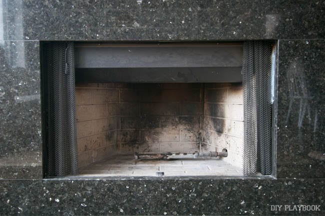 The dirty fireplace, before