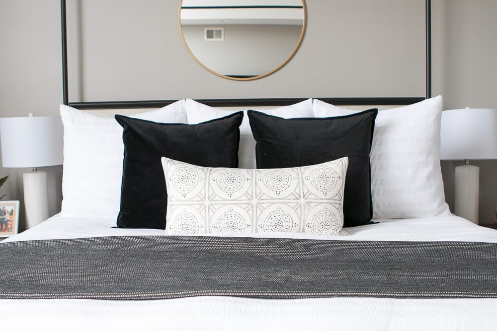 Decorative accent pillows brighten up the bedspread.