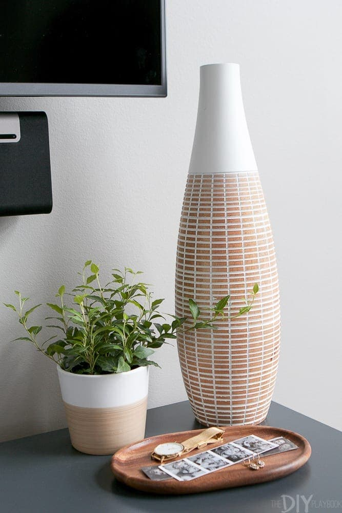 The decorative vase looks good with the plant.