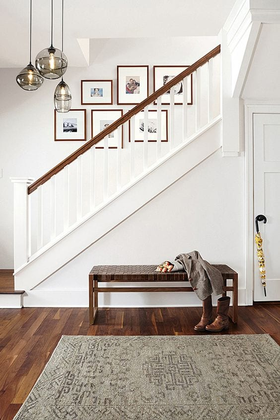 Entryway bench and stairwell from Room and Board