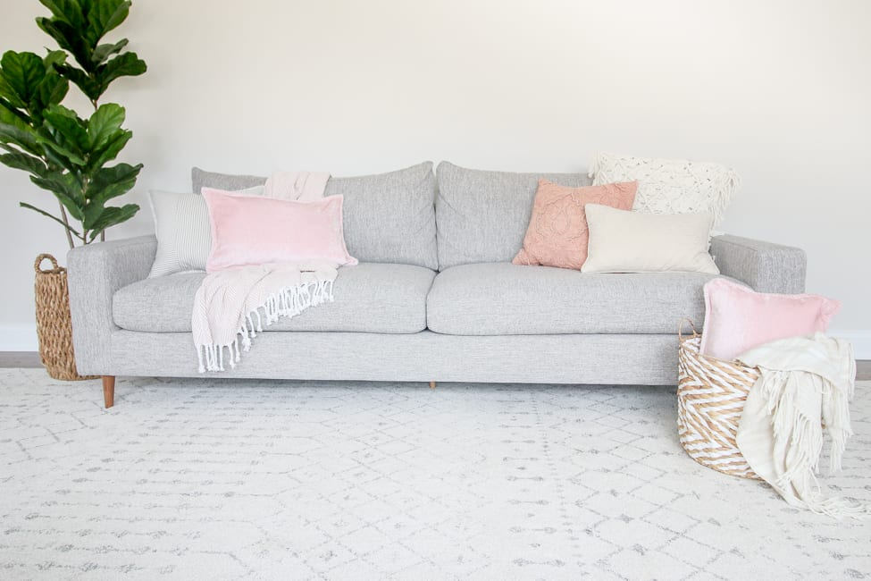 decorating a couch with blush and pinks