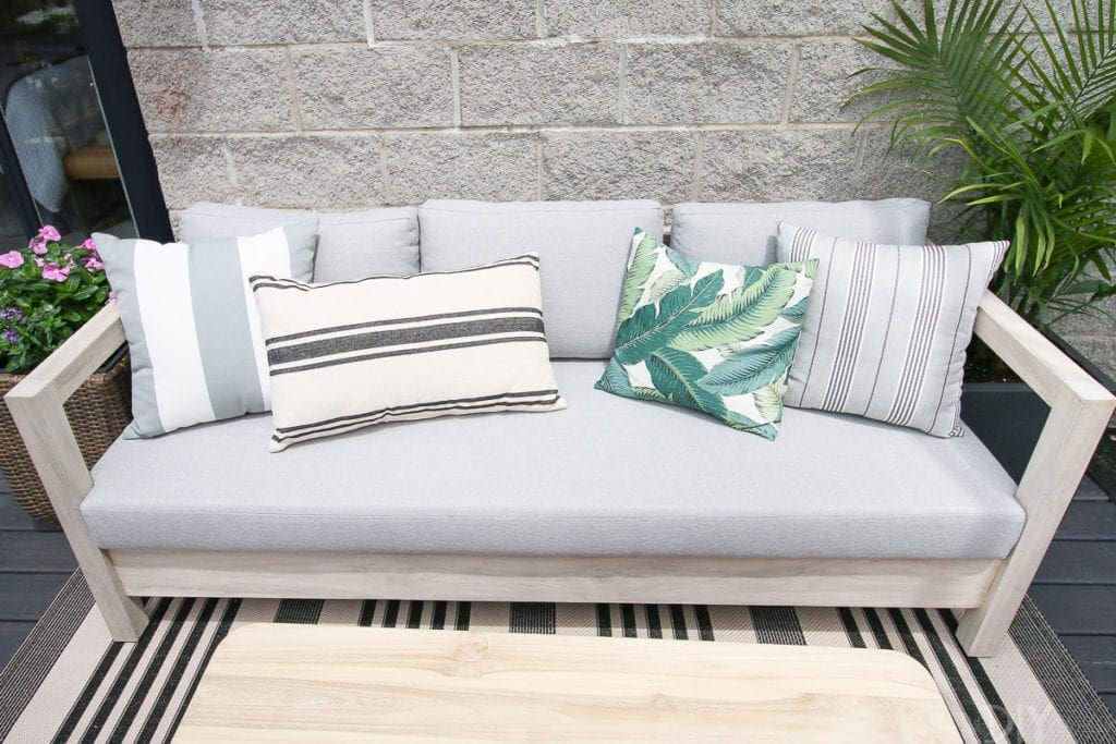 Try an outdoor couch with pillows on your balcony