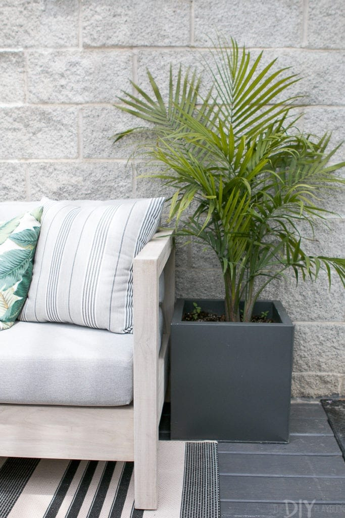 Add outdoor pillows to your sofa for pattern and warmth