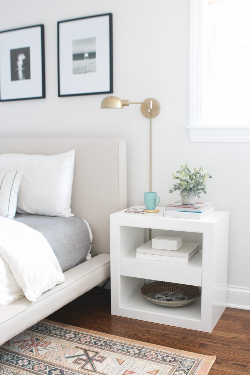 Gold sconces next to a bed
