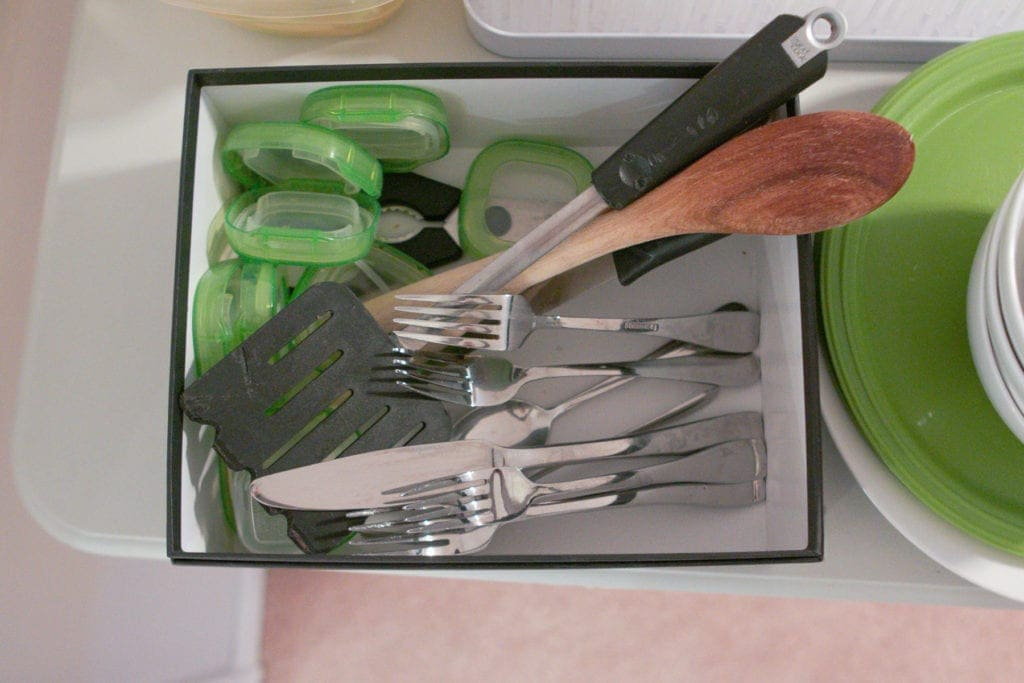 clean silverware in a temporary kitchen