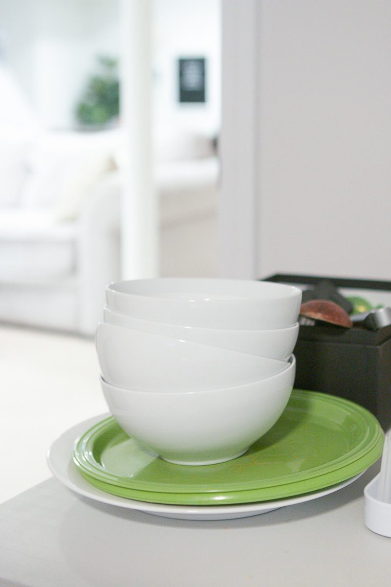 cleaning bowls in a temporary kitchen