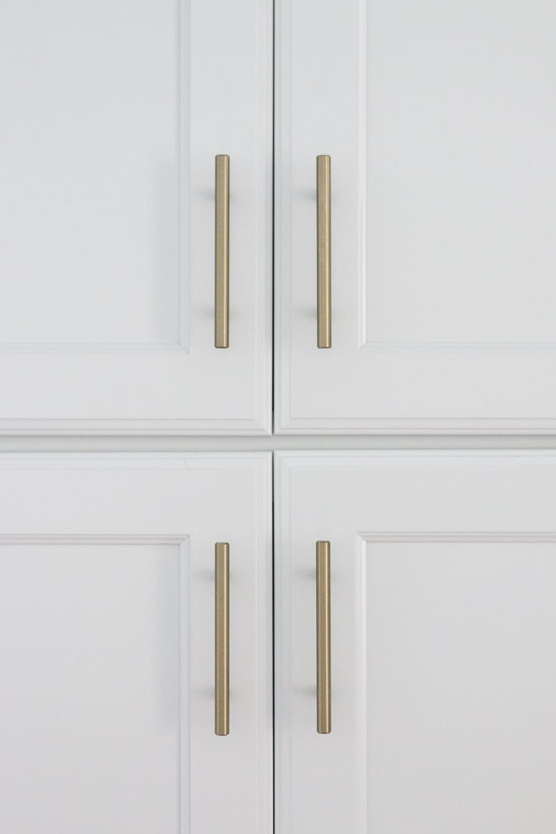 brass hardware on a white pantry