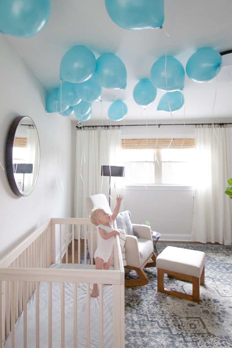 baby with balloons