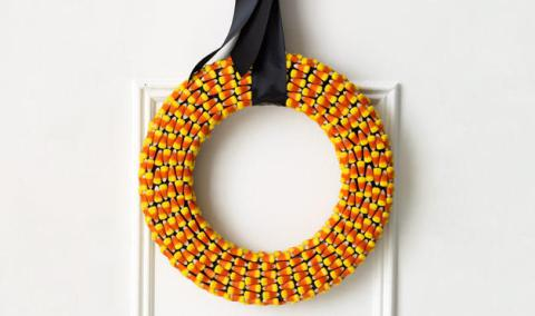 Don't eat all the candy corn, save some to make this sweet wreath, on Spearmint Baby.