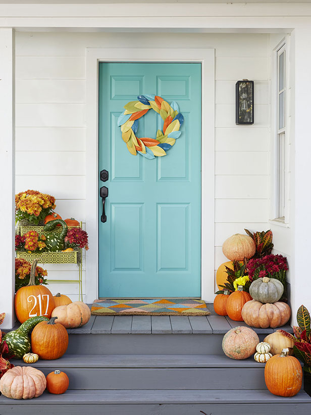 The beautiful wreath that looks like it's made from painted leaves. The pumpkin is also lovely and would be simple to make with a stencil and paint. Found on the HGTV blog.