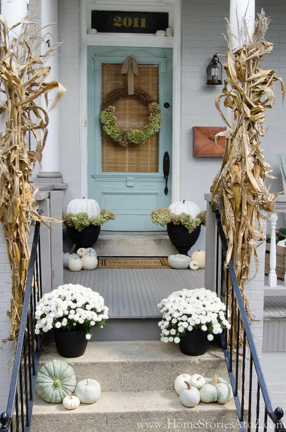 This Fall skip decorating with the dark reds and oranges and try out some beautiful white Mums and pumpkins. Found on Home Stories A to Z.