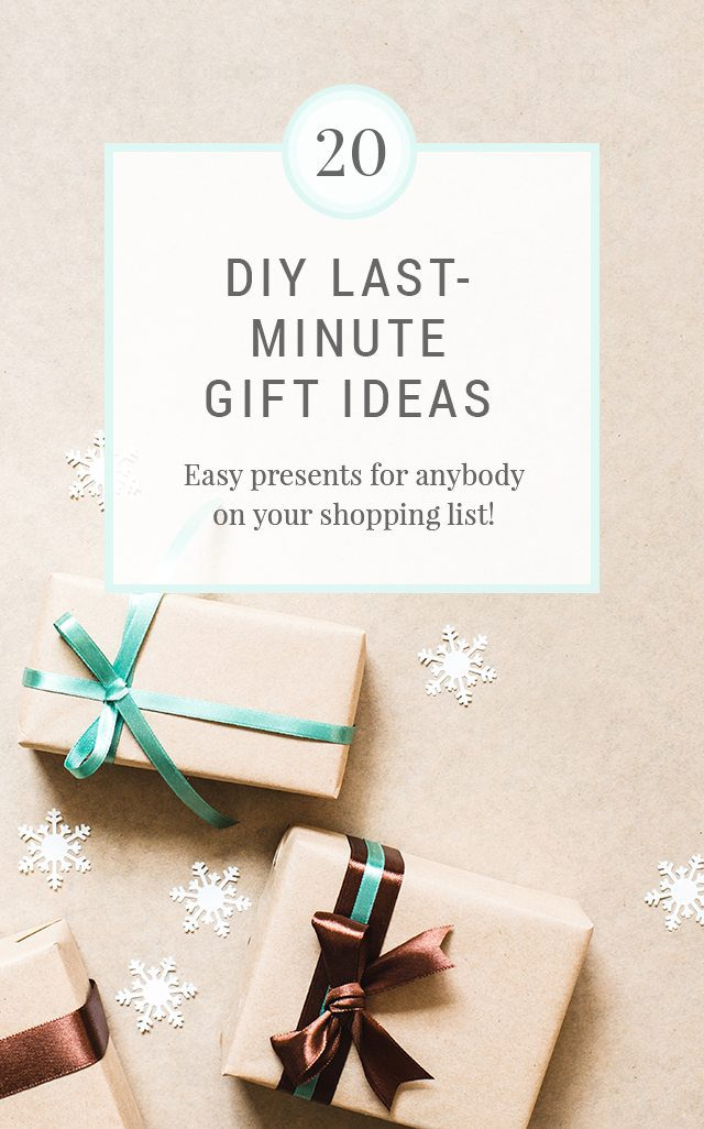 Christmas background with three gift boxes wrapped in kraft paper and paper snowflakes