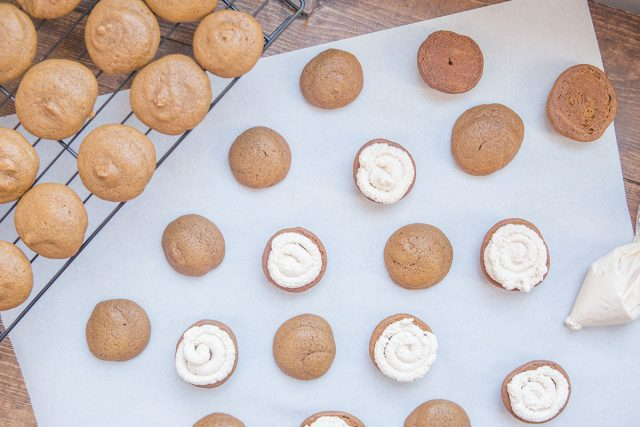 Pumpkin Whoopie Pie Recipe With Maple Spice Whipped Cream - Pipe Filling Onto Cookies
