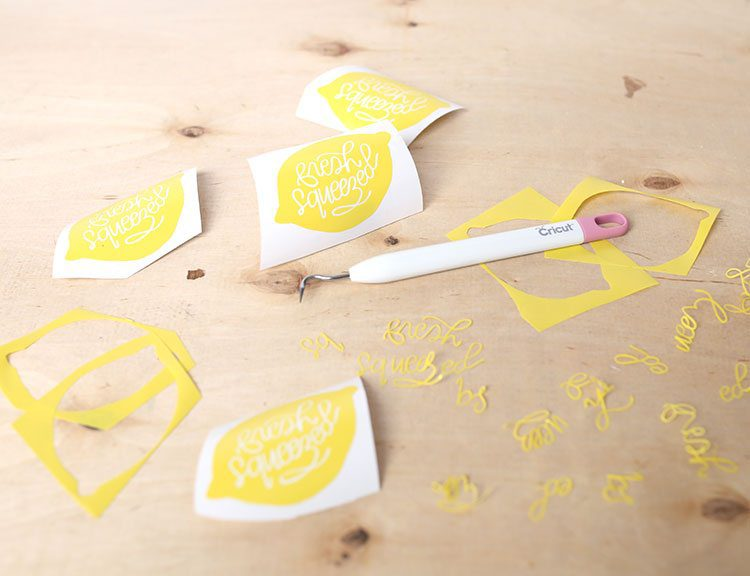 Vinyl lemon decals for Cricut machine on a wooden background