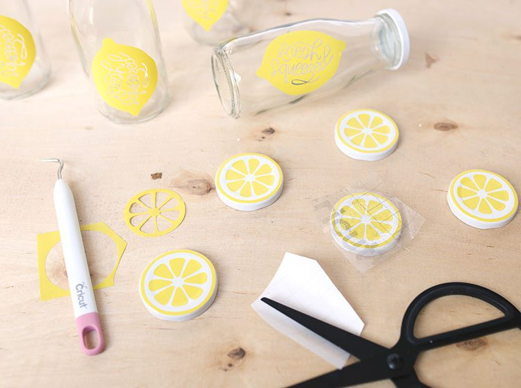 Bottle lids and glass milk bottles with handmade DIY vinyl lemon decals
