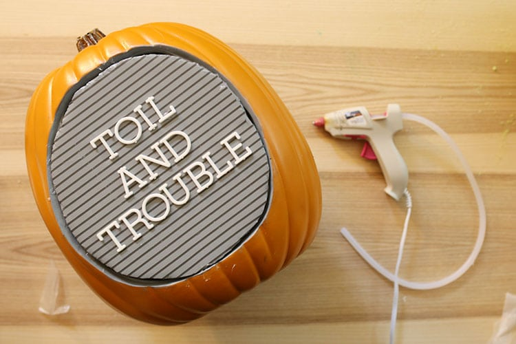 Adding letterboard insert to diorama fake pumpkin for DIY letter board pumpkin for Halloween