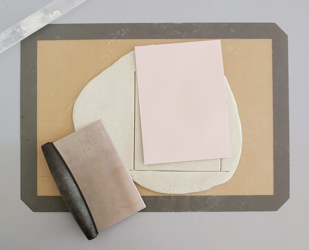 Air dry clay on a silicone baking mat to make a diy baby clay handprint keepsake frame