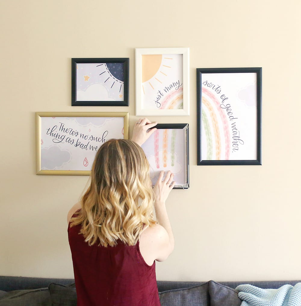 Woman with blonde ombre balayage hair puts a SnapeZo frame on a gallery wall